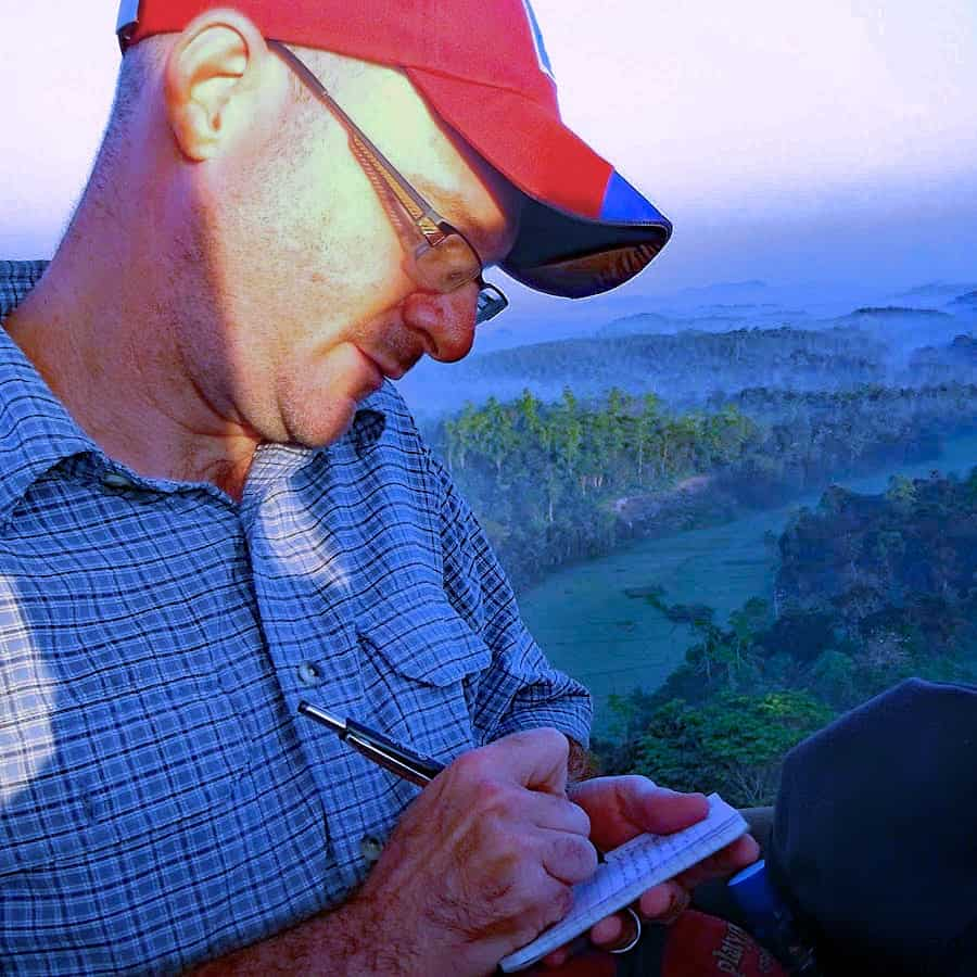 Dave Fox jots notes while on location